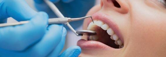 вставить зубы скидка